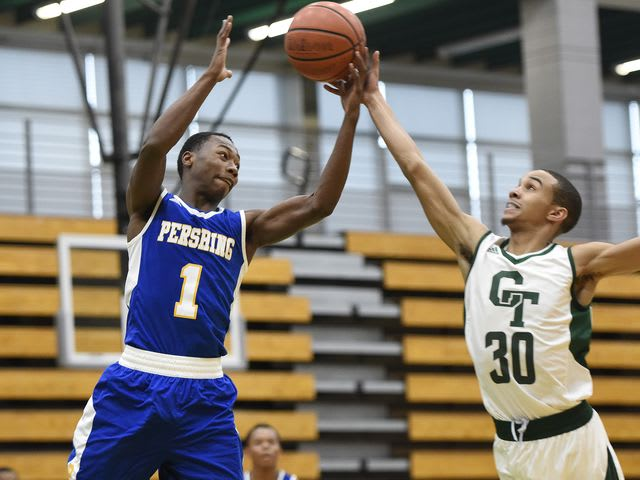 Pershing and Cass Tech players going for a rebound earlier in the season.