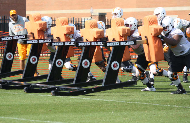Offensive line working the sled