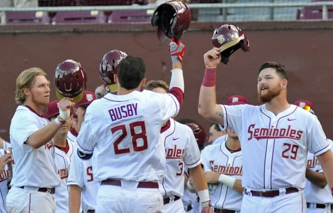 Florida State's Dylan Busby and Quincy Nieporte celebrate in the team's 16-3 win over Samford on Friday.
