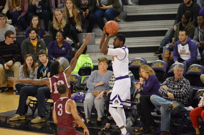 ECU's Caleb White launches in three of his game high twenty points in a 69-56 win over NC Central.
