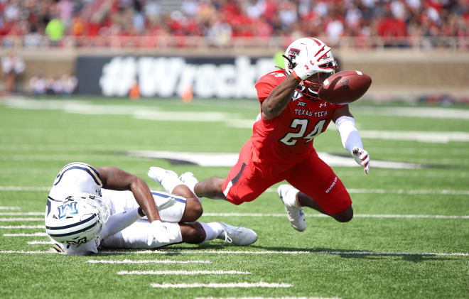 Lubbock native inside receiver Xavier White loses the ball yards away from scoring during Texas Tech's 45-10 win over Montana state.