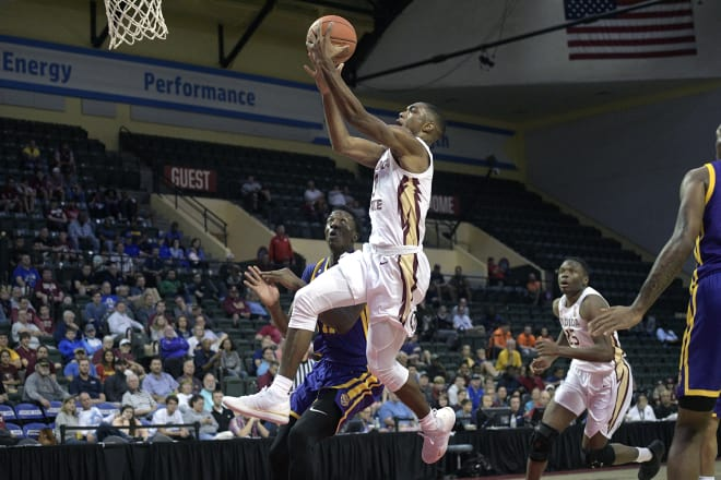 Junior guard Trent Forrest soars in for a layup Friday against LSU.