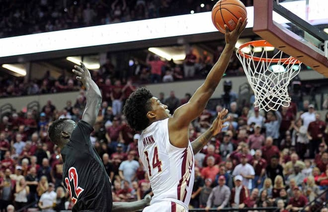 Terance Mann soars in for a basket Saturday against Louisville.