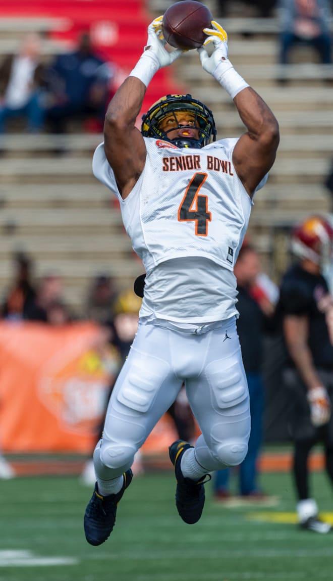Michigan Wolverines football's Josh Uche rose at the ...