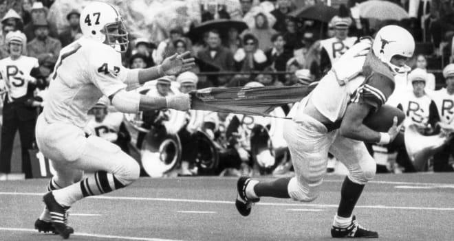 PSU defensive end Jim Laslavic pulls down Texas quarterback Eddie Phillips.