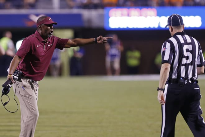 Second-year FSU coach Willie Taggart argues a call Saturday at Virginia.