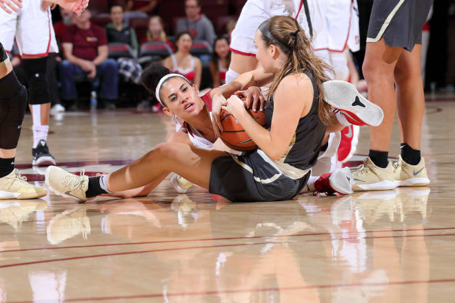 Kaylee Johnson fights for a loose ball against Colorado.