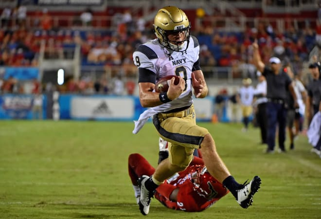 Midshipmen quarterback Zach Abey (9) runs the ball in for a touchdown against the Florida Atlantic Owls during the second half at FAU Football Stadium.
