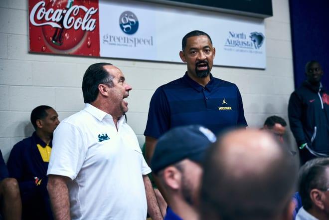 ND coach Mike Brey (left) and Michigan coach Juwan Howard