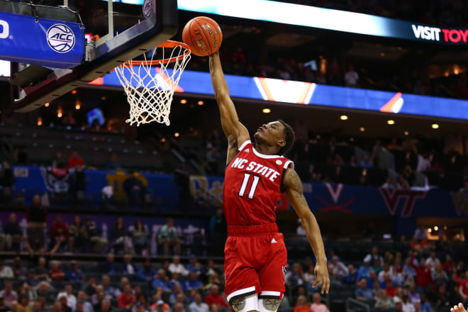 NC State Wolfpack basketball guard Markell Johnson goes for a dunk.
