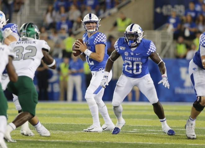 Kentucky quarterback Sawyer Smith sits in the pocket before picking a target.