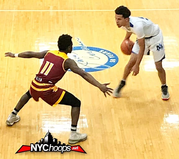 Joe Toussaint tries to contain Cole Anthony