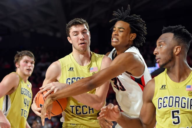 Evan Cole struggles for a rebound in the blowout loss to UGA