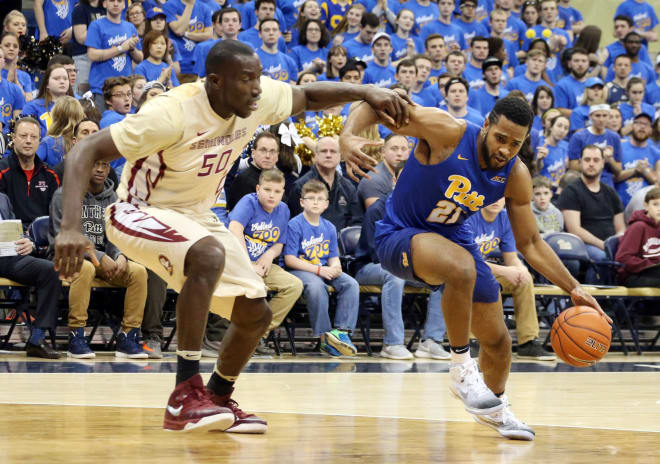 Pitt's Sheldon Jeter drives on FSU big man Michael Ojo during Saturday's game.