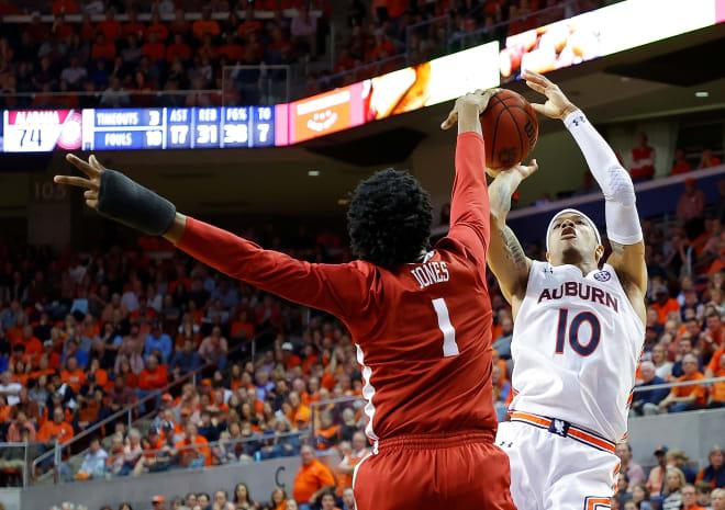 Alabama Crimson Tide basketball forward Herbert Jones block a shot on Auburn's Samir Doughty. Photo   Getty Images
