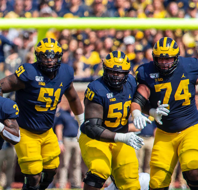 Michigan Wolverines football senior left guard Ben Bredeson (far right) is the lone captain on offense this season.