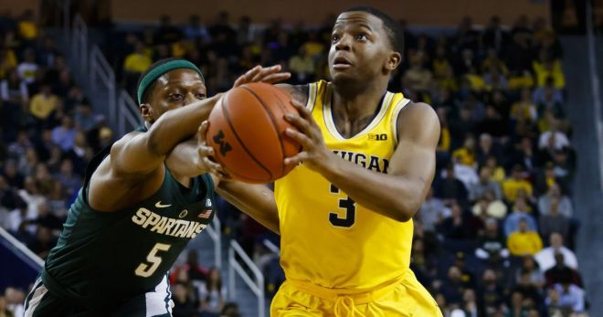 MI  smashes Nebraska behind Derrick Walton Jr.'s record 16 assists