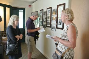 a tour group learns about womens history at the Susan B. Anthony House