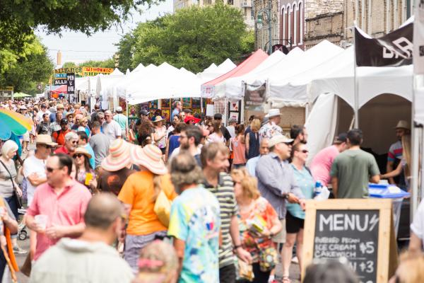 Crowd on the street at the Spring Pecan Street Festival
