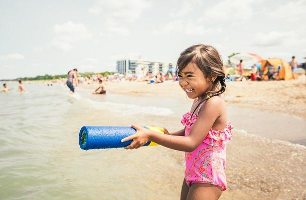 Little girl playing at Grand Bend Beach