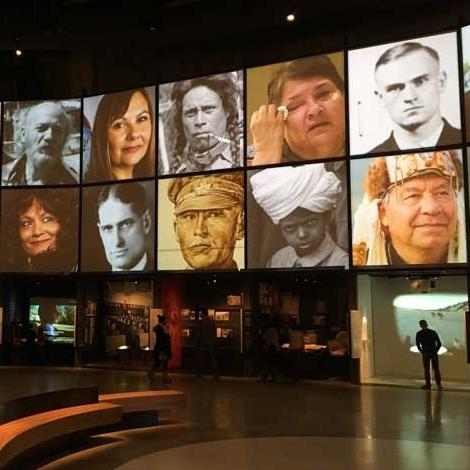 Museum-goers walk through the Canadian Journeys gallery at the Canadian Museum for Human Rights, as images of human rights icons are featured overhead