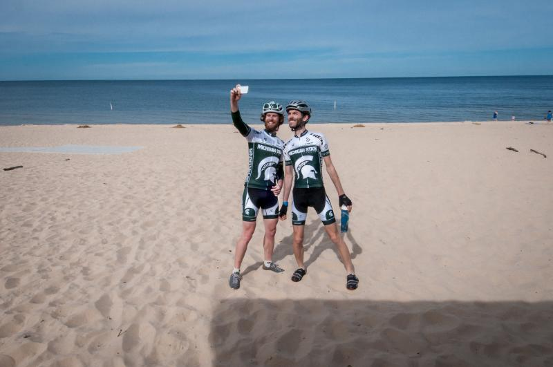 Gran Fondo cyclists taking a lake shore selfie