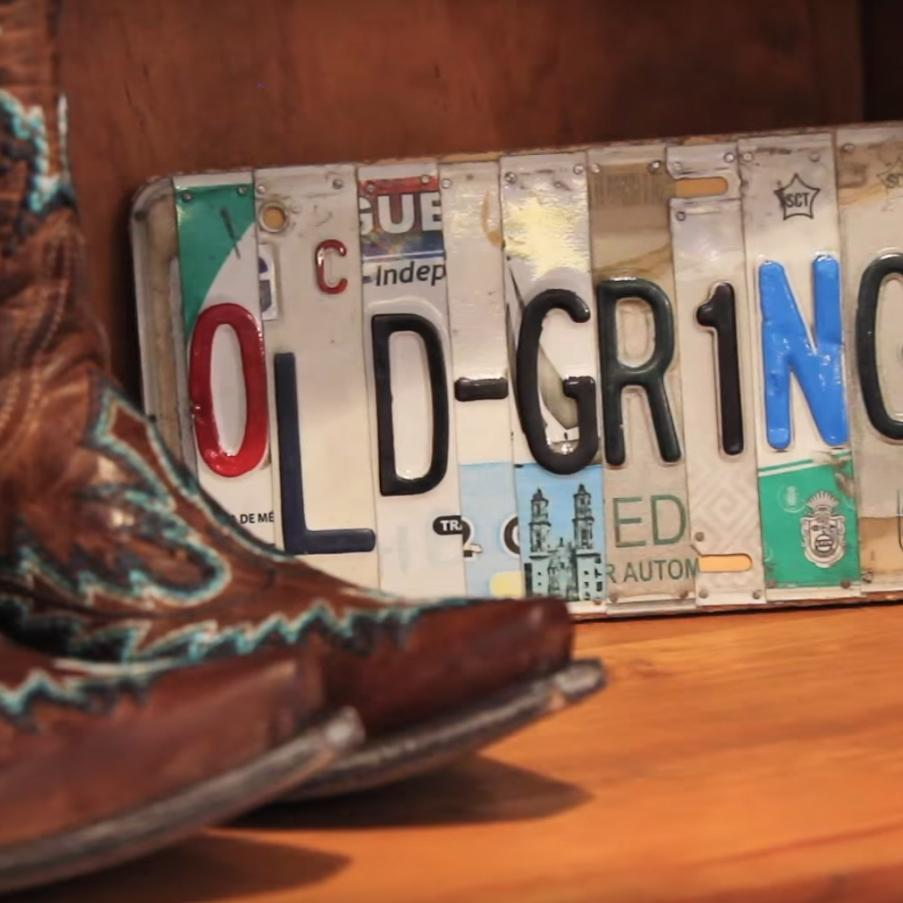 Cowboy boots and license plate at a store in Lakewood, Colorado