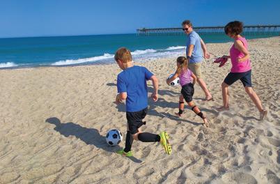 Family Soccer on beach