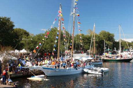 Boats line the Tchefuncte River for the Wooden Boat Festival