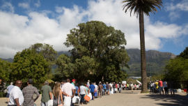 Lines of people wait to collect natural spring water for drinking during the Cape Town drought.