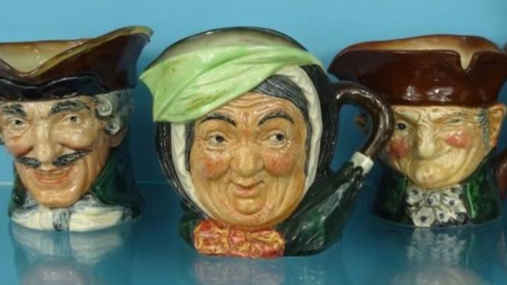 A variety of Doulton character mugs.