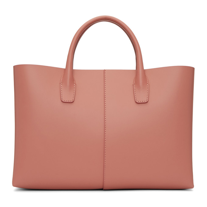 Blush-pink lined folded leather bag
