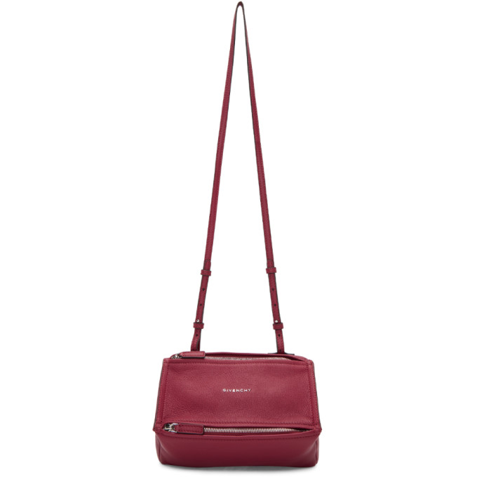 One rolled-leather top handle. Detachable black and white leather-trimmed  logo-jacquard shoulder strap. Front zip-fastening pocket 480b408e6a1f6
