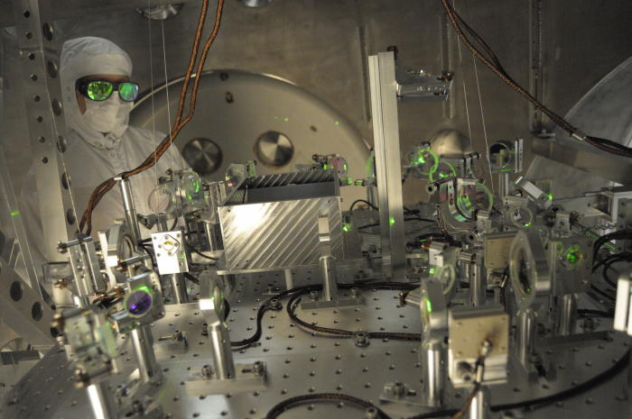 An installation specialist checks alignment of a test beam at the far end of one of LIGO's 4km detector arms: Picture: LIGO Laboratory