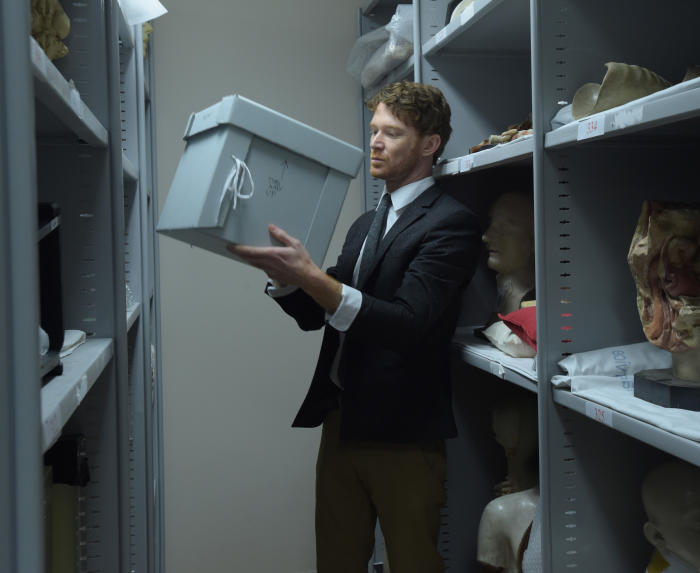 Curator Dr Ryan Jefferies in the musuem's storage room with Meritamun's mummified head. Picture: Paul Burston.
