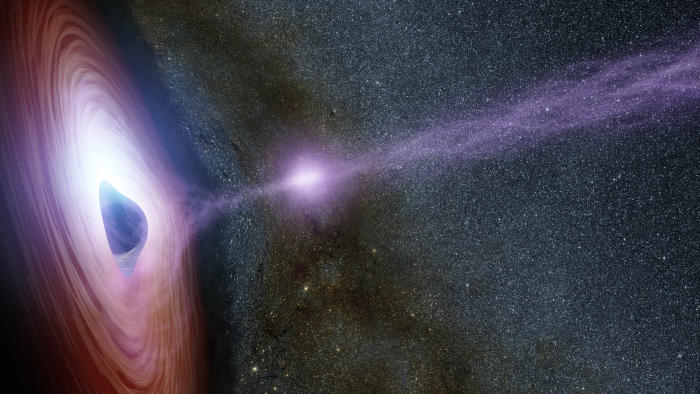 Artist's depiction of a supermassive black hole surrounded by a swirling disk of material falling onto it. Picture: NASA/JPL-Caltech