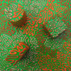 Metallic, Fluorescent, Dark Orange Line on Green