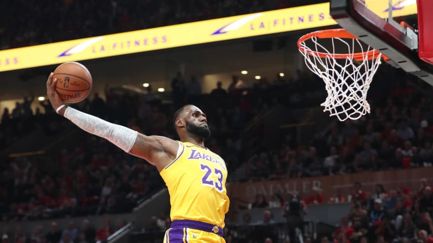 Watch: LeBron James has two huge dunks for first career Lakers points