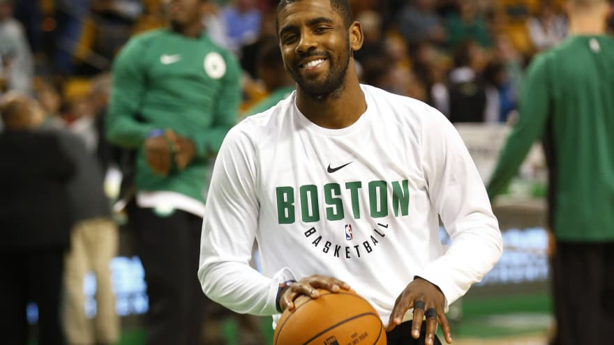 dc2783fc272472 Kyrie Irving gives his sneakers to young fan wearing his Cavs jersey ...