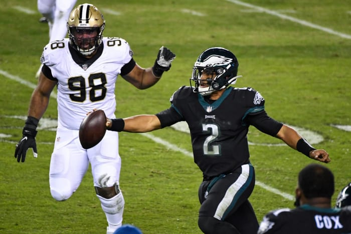 Jalen Hurts' first career start ends with upset of Saints