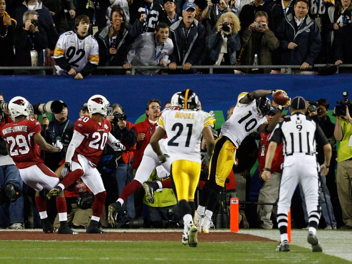 All-Santonio drive ends with storied grab